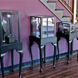 black pedestal display cases in a jewelry store