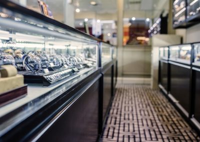 Custom black wood display cases for a jewelry store in a mall