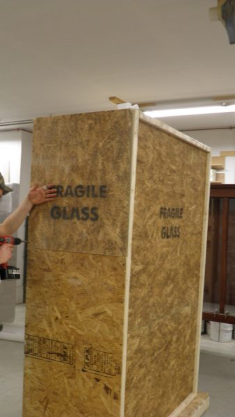 Removing Side Panels of Crated Display Case