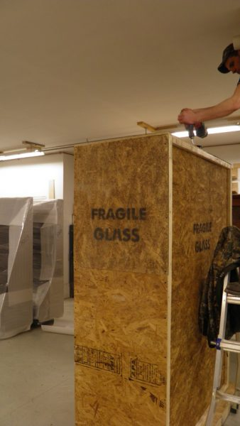 Removing the top panel of the crated display case