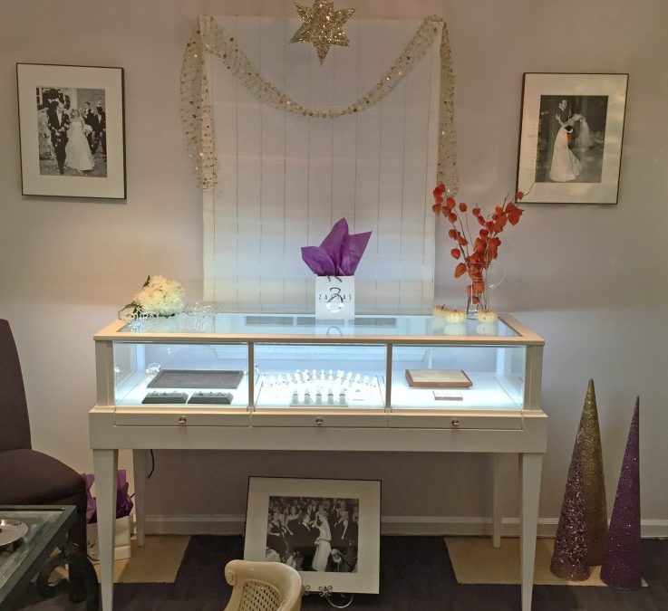White Tapered Leg Display With Three Pull Out Decks For Zaltas Gallery Of Fine Jewelry